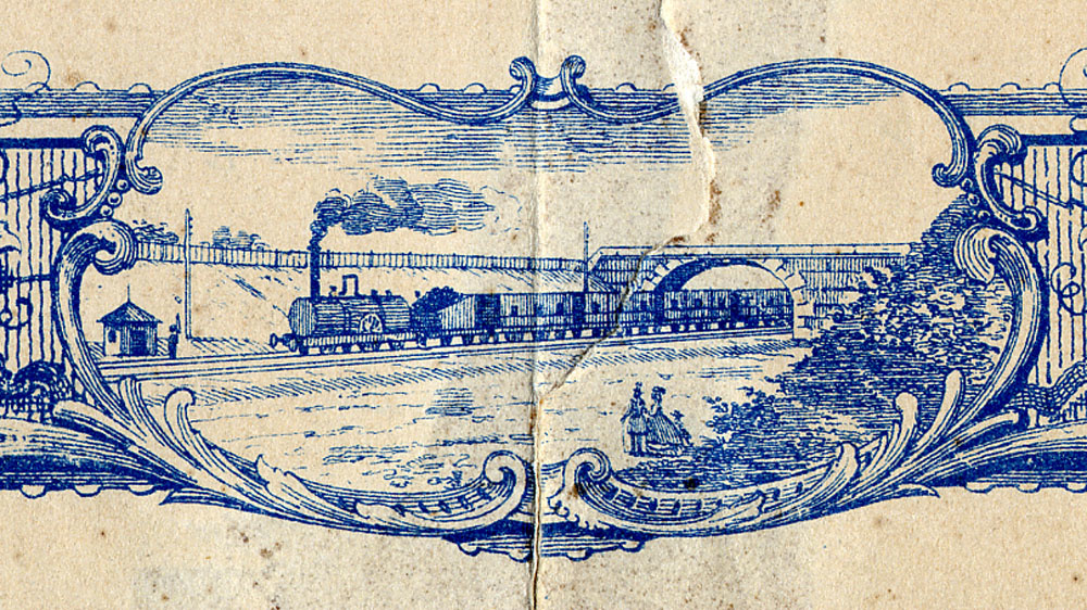 La vignette en bas au centre du cadre du diplôme montre un train