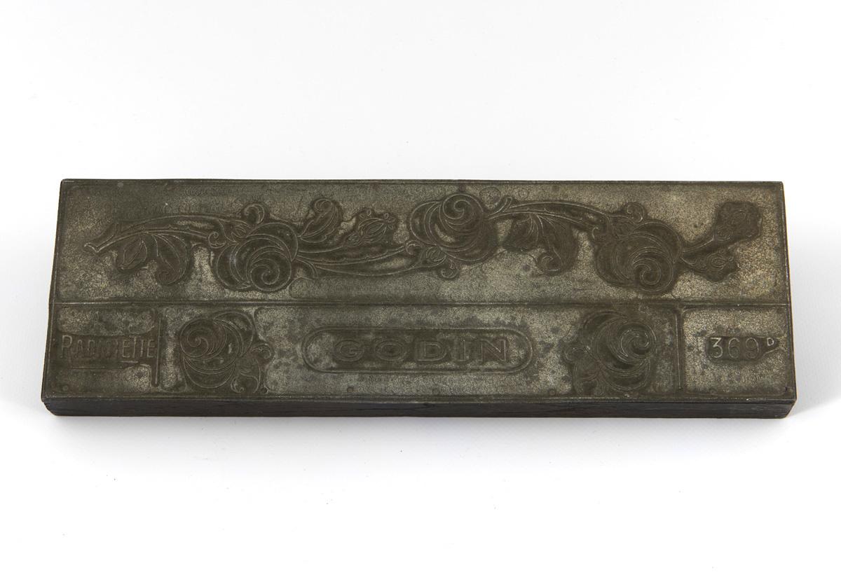 Matrice de gravure pour impression avec motif végétal et inscriptions publicitai
