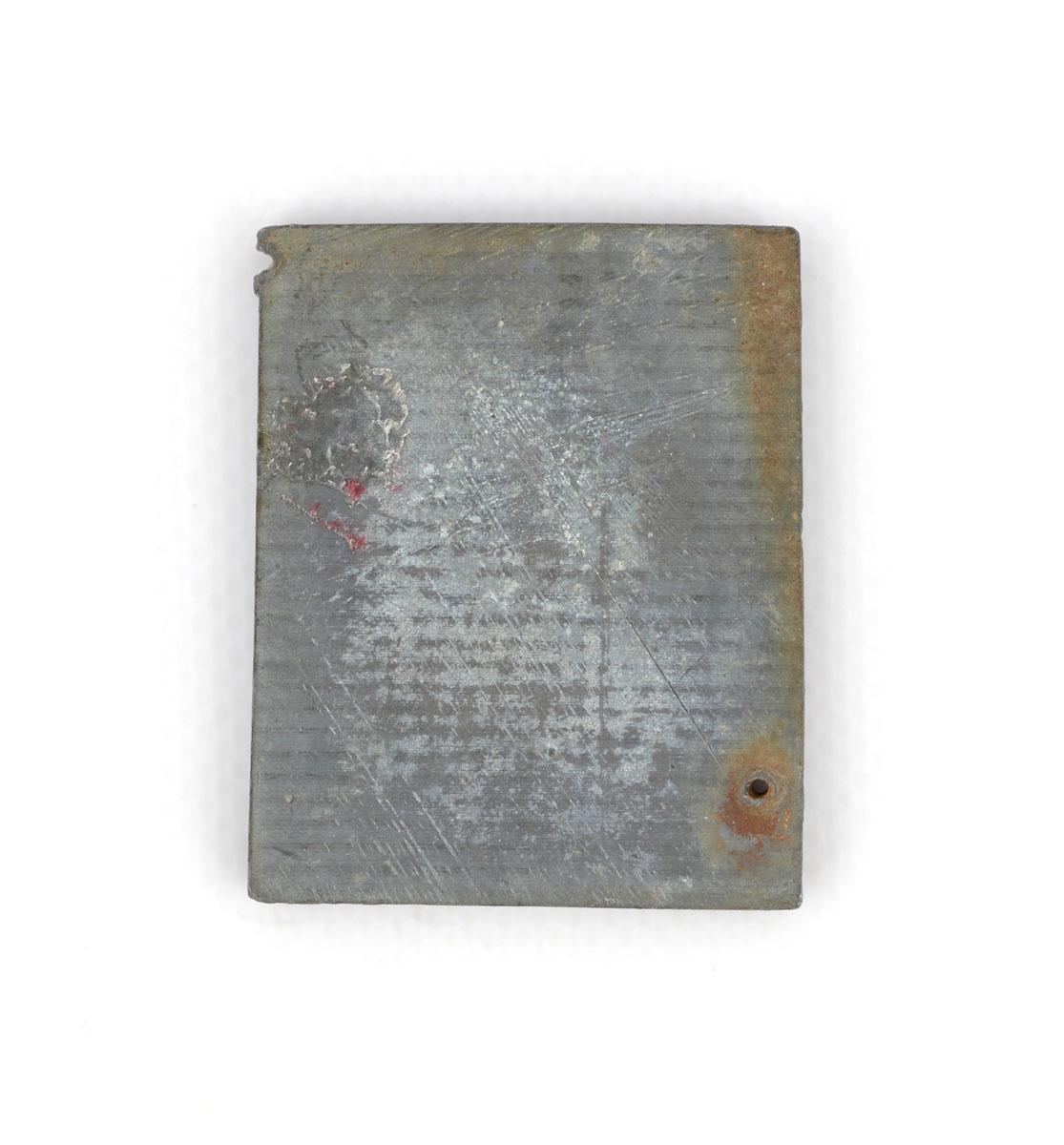 Vue du revers de la matrice de gravure figurant le foyer hygiénique n° 2346.