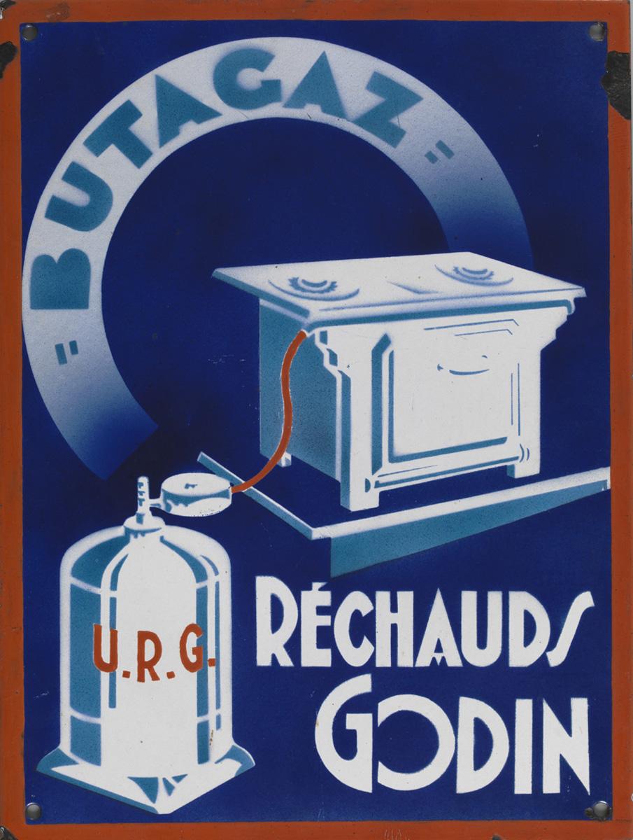 """La plaque publicitaire montre, sur un fond bleu, un réchaud """"Godin"""" alimenté par"""