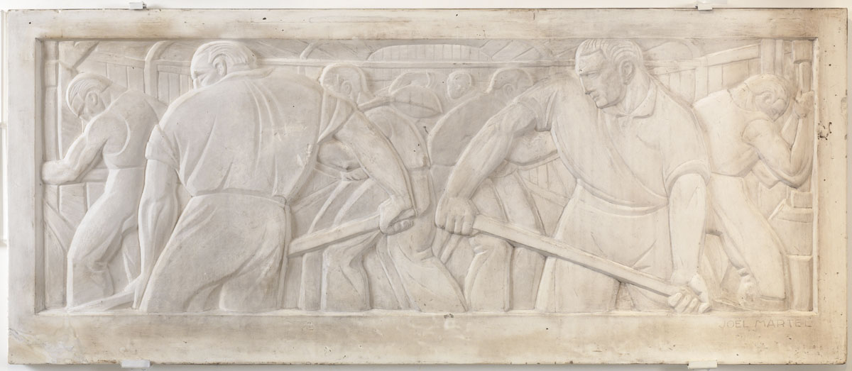Le relief représente des mouleurs dans la fonderie de l'usine du Familistère.